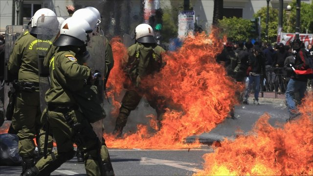 Riot police amid fires during clashes in Greece