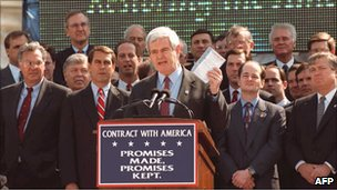 Newt Gingrich, centre, speaks on the steps of the US capitol in 1995