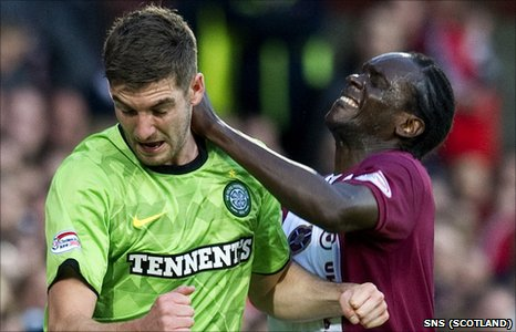 Celtic's Charlie Mulgrew and David Obua of Hearts