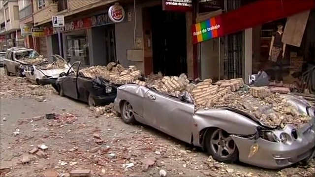 Cars crushed by rubble