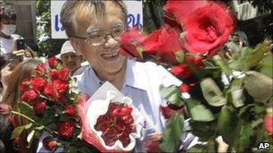 Somsak Jeamteerasaku, a Thammasat University historian, outside police station, May 11, 2011