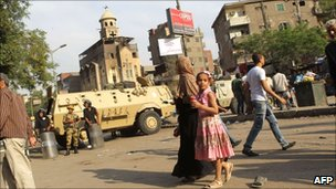Egyptian military police guard the Virgin Mary church in Imbaba in the Egyptian capital of Cairo on May 10, 2011