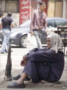 An Egyptian building worker waits on a street corner for an assignment, in Cairo, Tuesday May 10, 2011