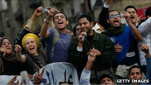 Anti-government protesters chant and sing in Tahrir Square January 30, 2011 in Cairo