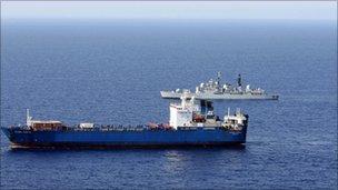 HMS Liverpool shadowing a vessel off the Libyan coast
