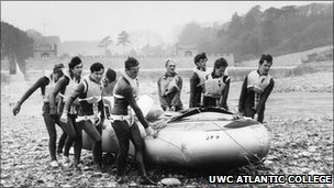 Staff and students carry an inflatable boat (Copyright: UWC Atlantic College)