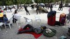 Emergency workers set up tents in a square in Lorca, Spain - 12 May 2011
