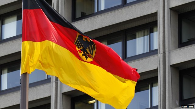 German flag flutters in front of the headquarters of the German central bank