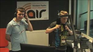 Two boys listening to radio