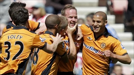 Jody Craddock is congratulated by his Wolves team-mates after scoring their opening goal at Sunderland