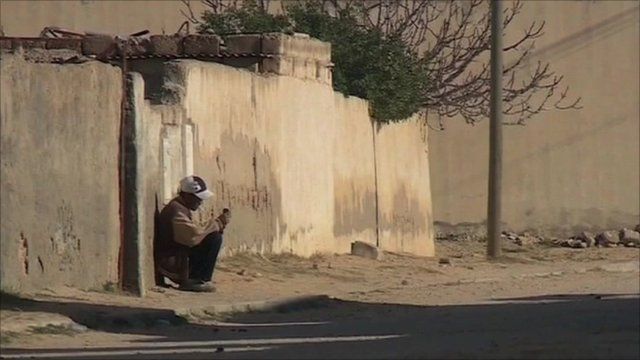 Man sits in Tunisian street
