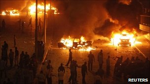 Cars burning outside Egypt's state TV building in central Cairo - 15 May 2011