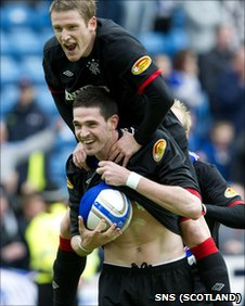Kyle Lafferty celebrates his hat-trick for Rangers