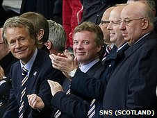 Rangers owner Craig Whyte and some club directors applaud the team's win against Kilmarnock