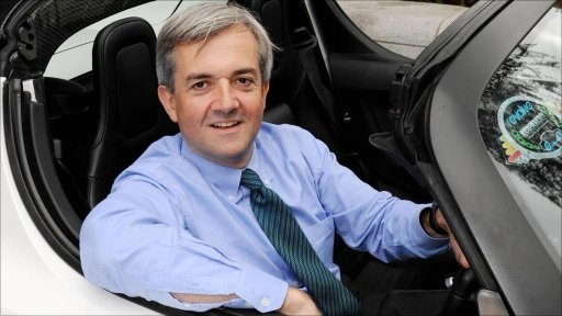 Energy Secretary Chris Huhne sitting in a car