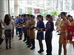 Girls representing casinos greet people at the Chinese border crossing