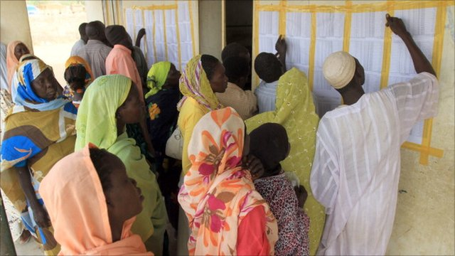 Sudanese voters check a list at a polling station where people are voting in the gubernatorial and legislative elections being held in Kadugli, in Sudan&#039;s oil-producing state of South Kordofan. (2nd May 2011)