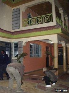Police inspecting the ground where Wanjiru fell
