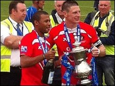 Captain Paul Lorraine with the play-off cup (Keith Chase EUFC)