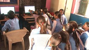 Children in a classroom looking at a PC