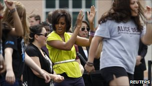 Michelle Obama dances with school pupils