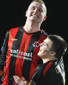 Jordan Owens celebrates a goal with Crusaders team-mate Stuart Dallas