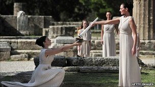 Actresses pass the flame at the lighting ceremony in Olympia ahead of the Vancouver 2010 Winter Olympics