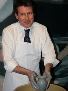 Lord Sebastian Coe throws a pit during a visit to Wedgwood