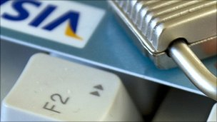 Padlock and a credit card on a computer keyboard