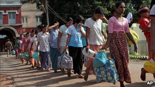 Prisoners walk out Burma&#039;s Insein prison after they were released under a government amnesty