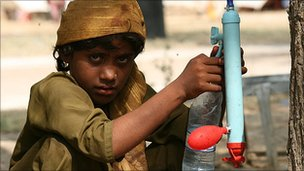 A child using a purifier in Pakistan