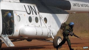 UN Ghanaian peacekeepers in Ivory Coast exit from a military helicopter to take part in manoeuvers