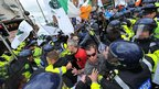 Irish Gardai clash with demonstrators during a protest in Dublin