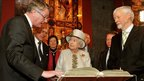 Queen Elizabeth II and the Duke of Edinburgh are told the story of the Book of Kells