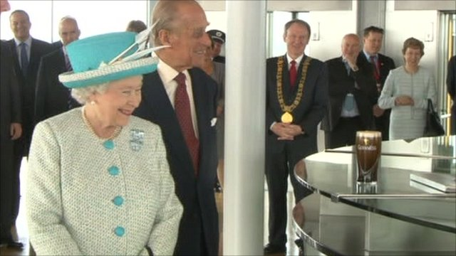 The Queen visited Dublin's Guinness Storehouse, where she was served a pint of Ireland's famous tipple.