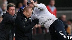 Celtic manager Neil Lennon being attacked