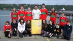 Gethin Jones with pupils from secondary schools in and around Bangor