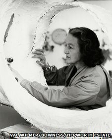 Barbara Hepworth at work on the plaster for Oval Form (Trezion) , 1963, Photograph: Val Wilmer, Bowness, Hepworth Estate