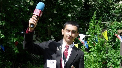 School Reporter holding microphone in the air