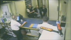 CCTV of Mr Read being brought  into Bath police station