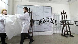 Restored Auschwitz sign unveiled by technicians