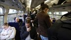 Passengers on a busy commuter train
