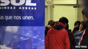 Friends and family members of victims of a plane crash react at Neuquen airport, 19 May, 2011