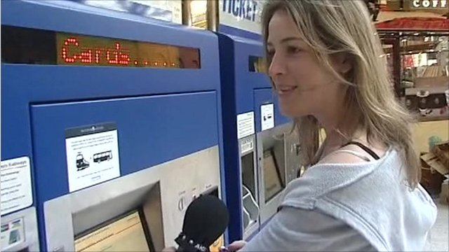 Woman buying ticket at train station