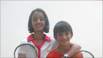 Kenyan squash player with her brother