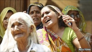 Women cry after family members are arrested by police following protest - 08May 2011