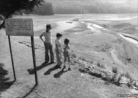 Local residents survey the Taf Fechan reservoir in South Wales, nearly dry because of drought, 12 August 1976