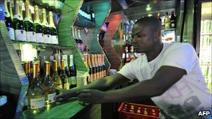 A bar worker in Yopougon, Abidjan
