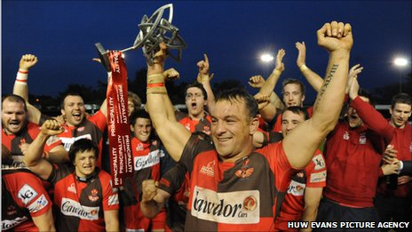 Llanelli captain Craig Hawkins lifts the Welsh Premiership title
