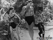 Actor Johnny Weissmuller (centre) in a scene from a Tarzan film